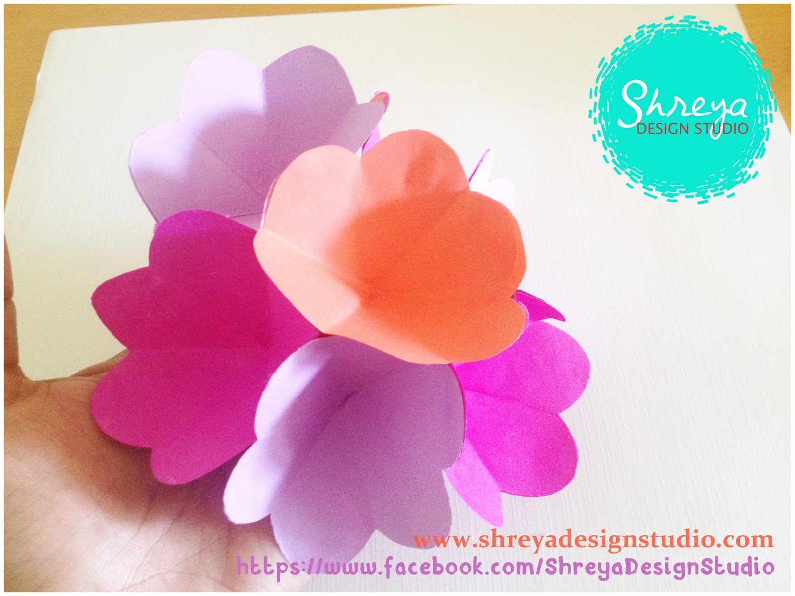 Tutorial how to make a seven flower pop up card shreya design take a card stock paper sheet or a thicker chart paper or ivory paper measuring 11 x 9 inches you can choose the paper which compliments with your flower thecheapjerseys Gallery
