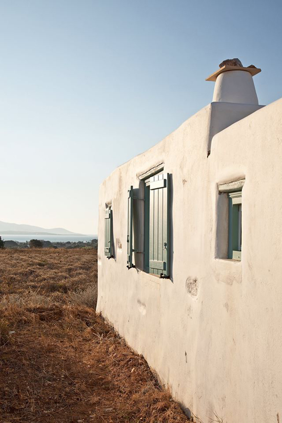 A small white house in Antiparos island in Cyclades, Greece designed by VOIS Architects. Photo by Yorgos Kordakis. See more at www.grecianparadise.com