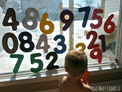 Large homemade foam numbers stick to windows when wet from And Next Comes L