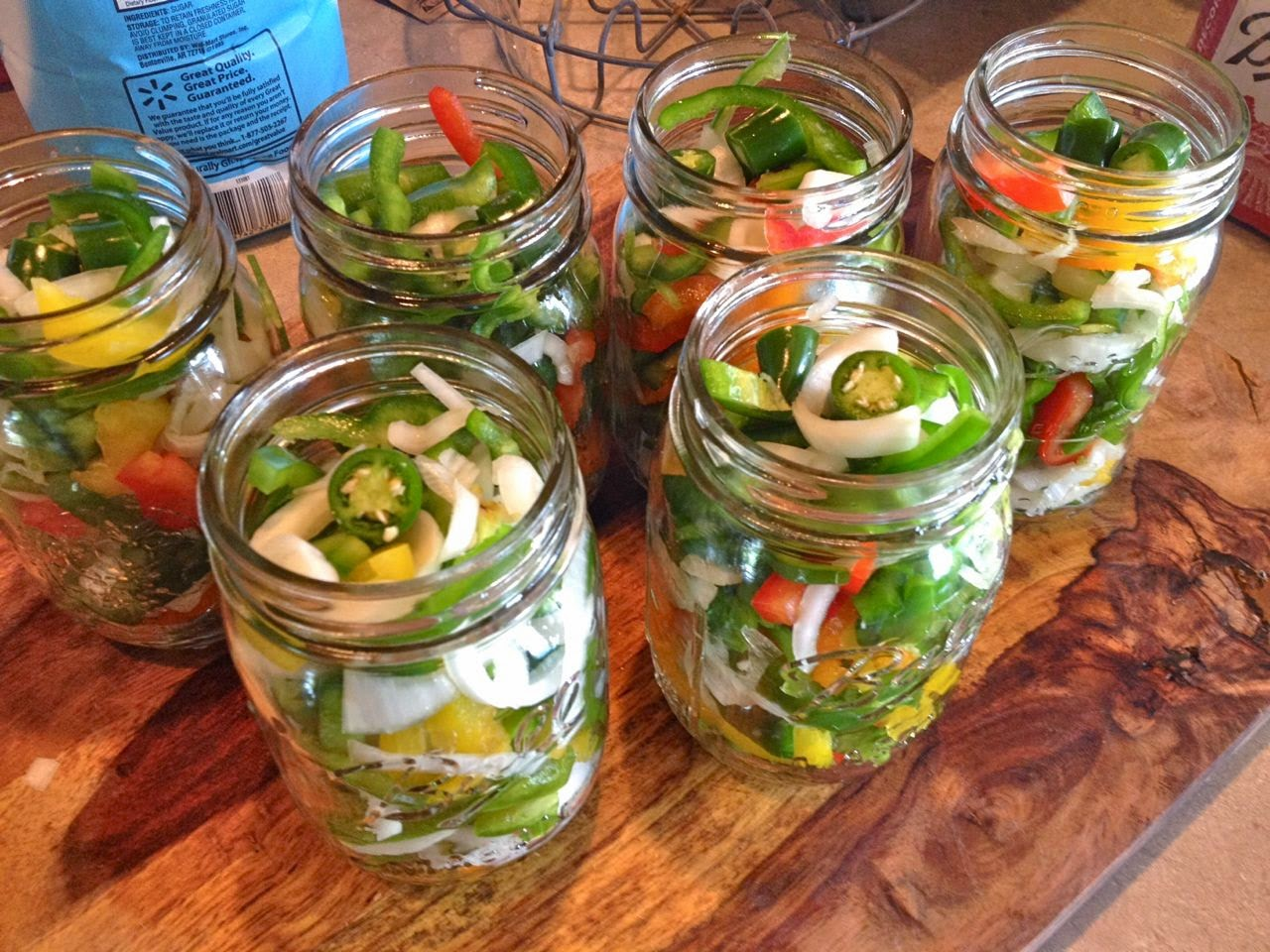 ... stuffed all the peppers and onions into the jars, leaving the