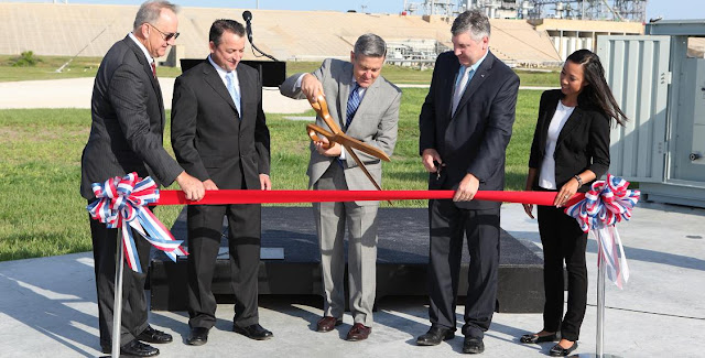 Center Director Bob Cabana, center, helps cut the ribbon on the new Small Class Vehicle Launch Pad, designated 39C, at NASA's Kennedy Space Center in Florida. Also helping to cut the ribbon are, from left, Pat Simpkins, director, Engineering Directorate; Rich Koller, senior vice president with design firm Jones Edmunds; Scott Colloredo, director, Center Planning and Development; and Michelle Shoultz, president of Frazier Engineering; The new launch pad, located in the southeast area of the Launch Pad 39B perimeter, is designed to attract smaller aerospace companies and enable them to develop and launch their vehicles from Kennedy. The Ground Systems Development and Operations Program oversaw construction of the new pad and is working with Center Planning and Development to grow commercial space efforts at Kennedy. Credits: NASA
