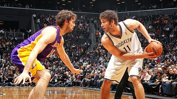 Pau Gasol defends Brook Lopez in a game last year
