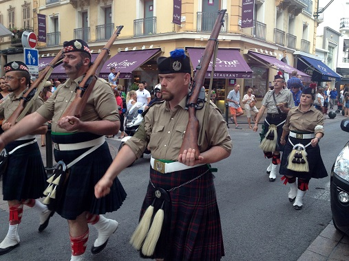 Walking the parade in Cannes with kilts and guns