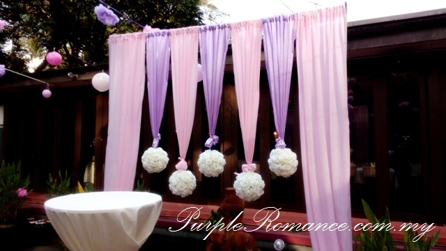 Photo Album Table Decoration, outdoor, pom pom flowers, paper lanterns, honey comb, kuala lumpur, Rama V Fine Thai Cuisine, USA embassy, fairy lights, modern, elegant, sweet, purple, pink, satin, floral, flower, stage backdrop, photo booth, indoor, outdoor, western, pond