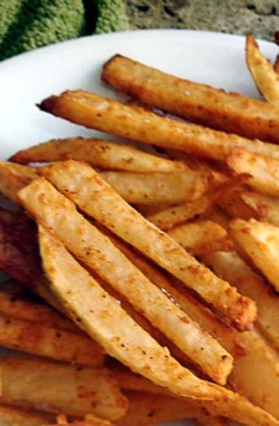 Crispy baked fries. The secret is to get rid of as much starch as possible before baking in the oven.