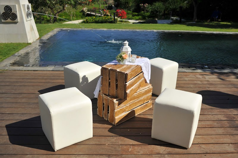 white ottomans and brown washed crates