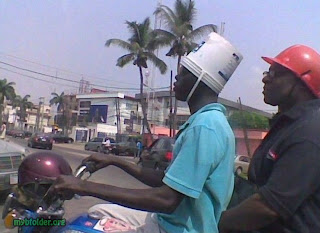 plastic bucket as helmet on motorcycle