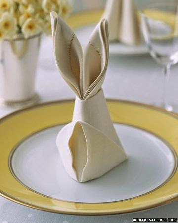 bunny folds napkins for Easter