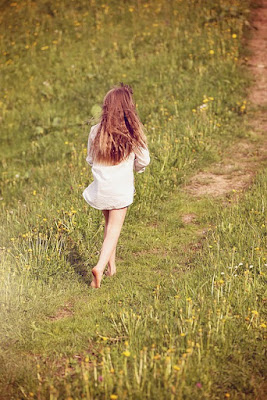 barefoot girl on a dirt path