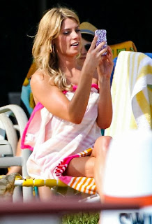 And it's true as Ashley Greene enjoyed her day with chatted on her phone. She shined her beauty with her long blonde hair.