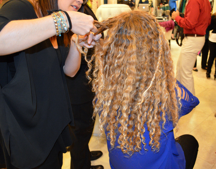 Blo Dry Hair Salon stylist braiding blonde curly hair