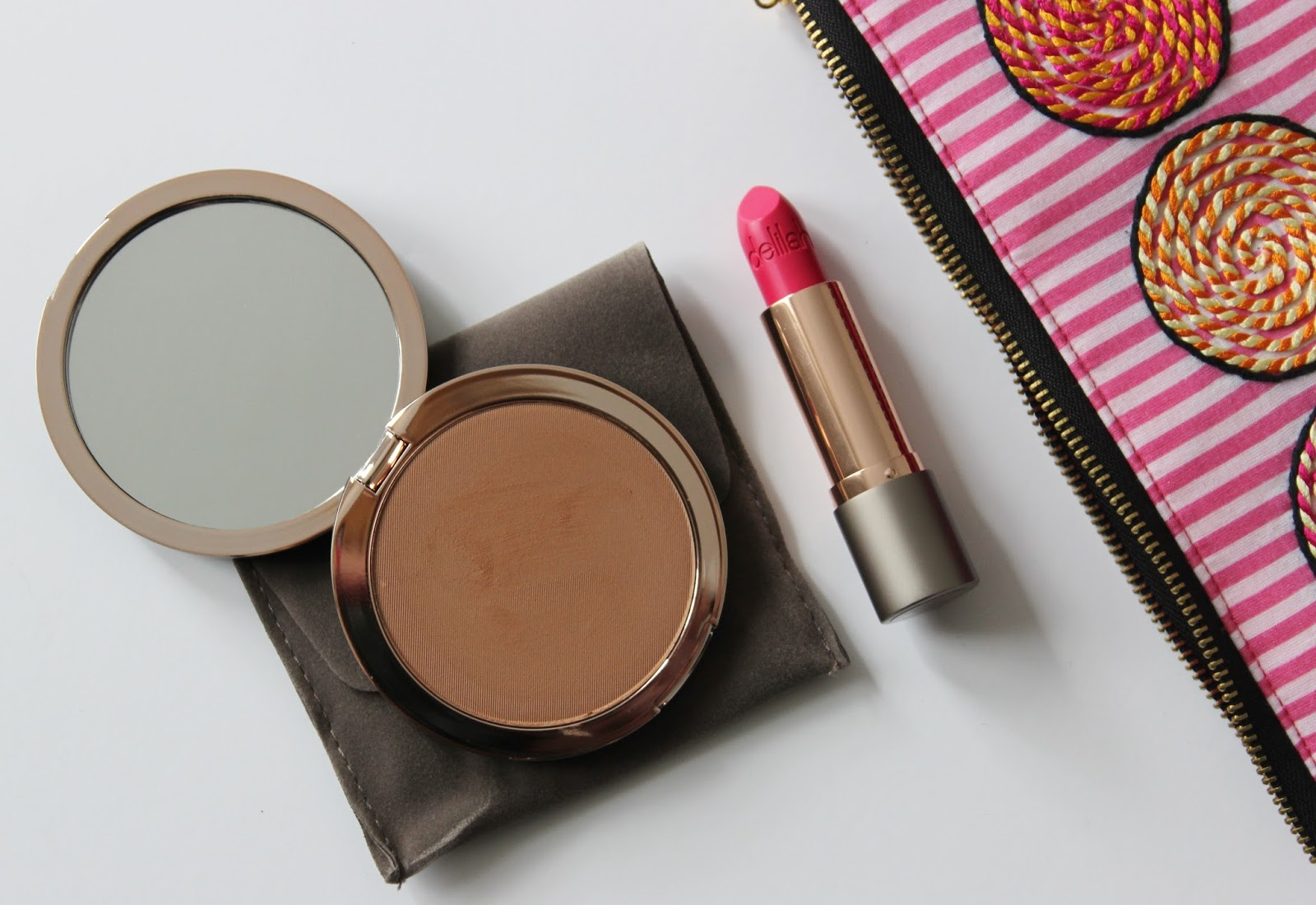 Delilah cosmetics sunset bronzer and Stiletto lipstick