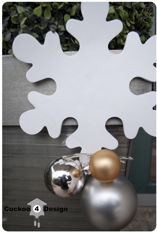large white craft store foam snowflake and silver ornaments
