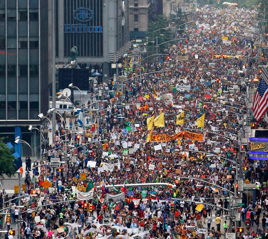 Throngs at the People's Climate March Sunday in New York City. The march filled 80 blocks. (Credit: Climate Action Network International/Flickr)  Click to enlarge.