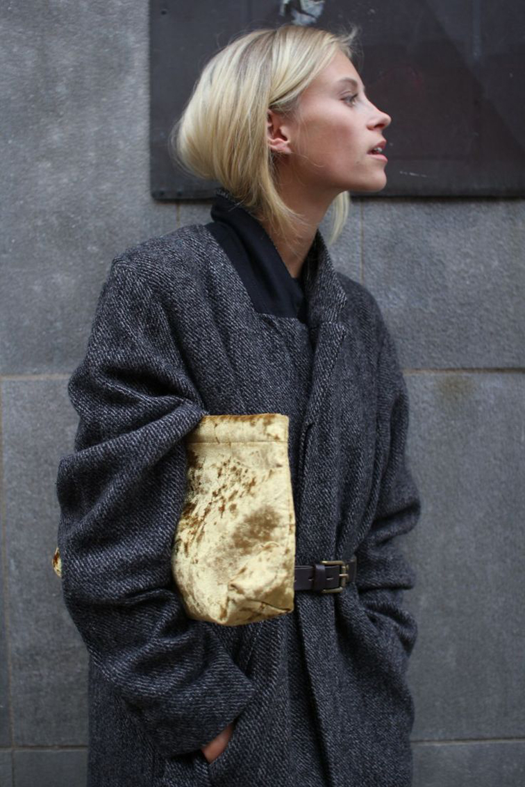 Street style, Isabel Marant chevron oversized belted coat, gold velvet clutch, messy blond hair