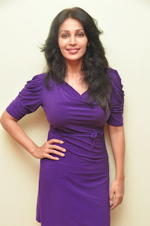 Asha Saini in a Short Purple Gown on Chair