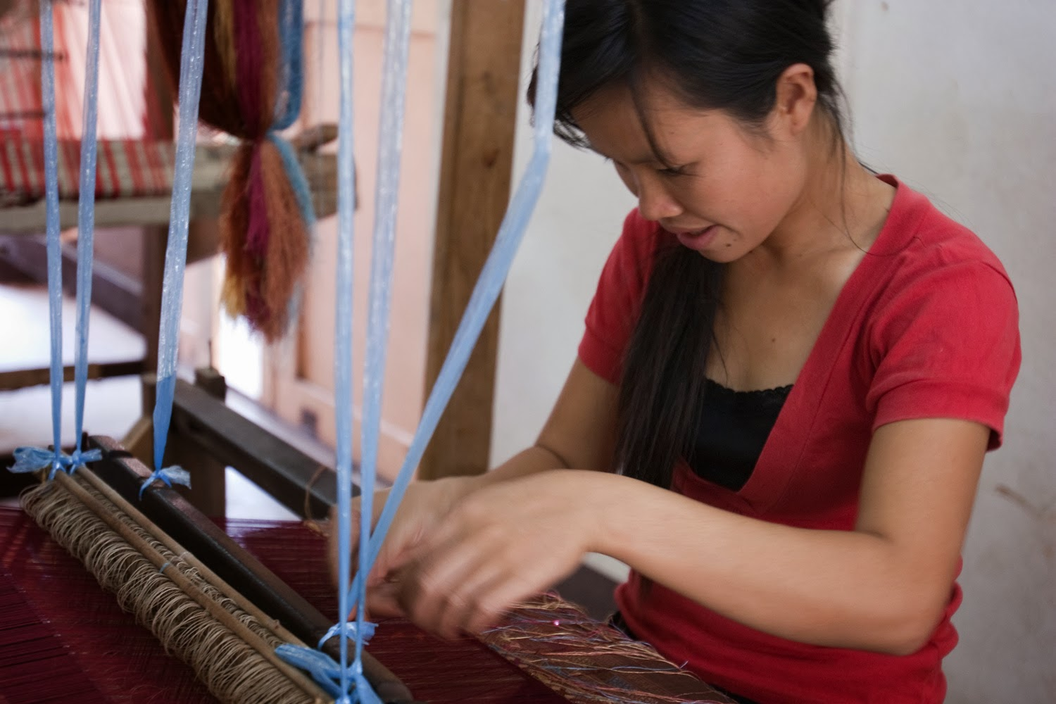 A young Lao weaver at the Houey Hong Vocational Training Centre for Women creates silk that reflects her culture and helps support her family.