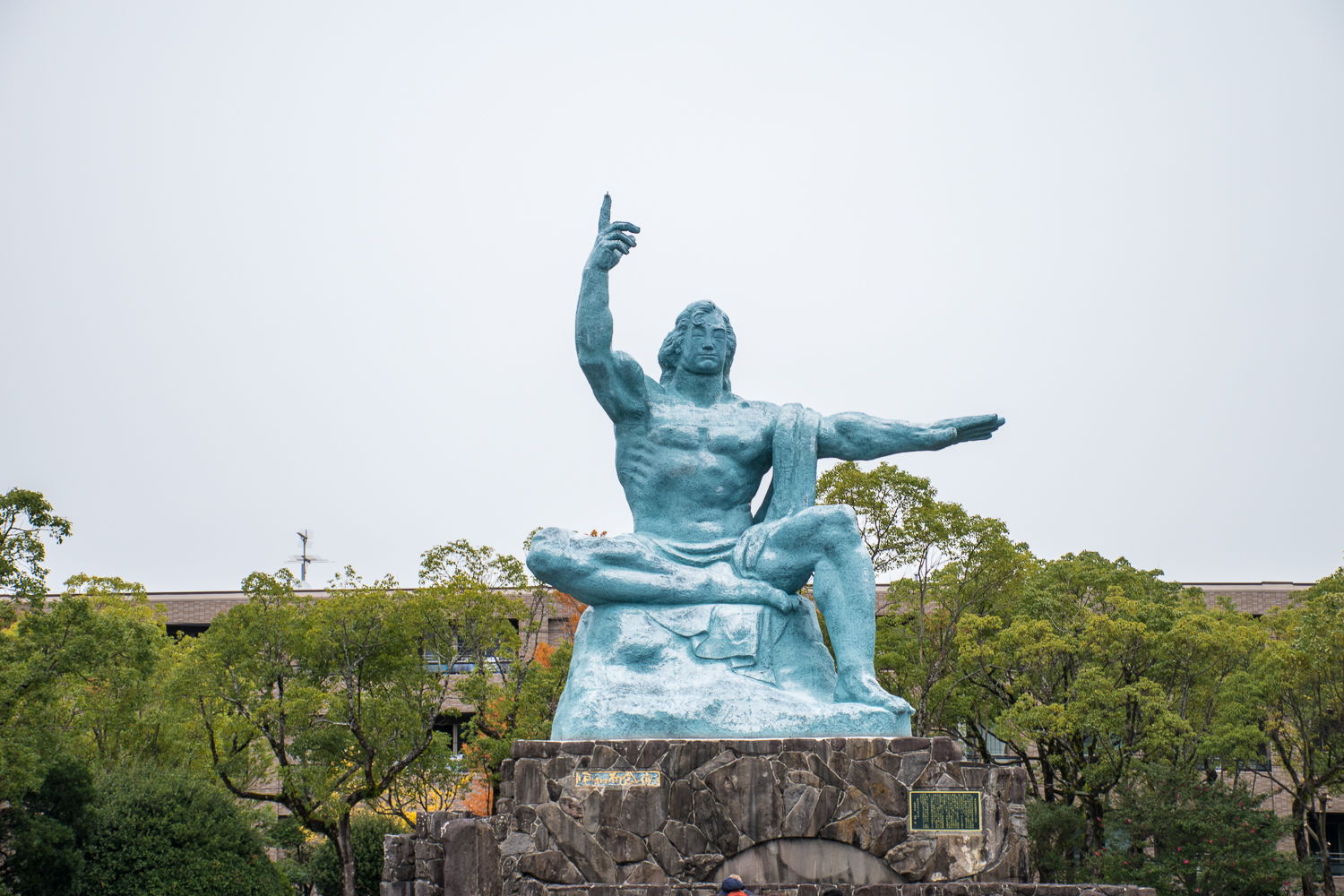 atomic bomb and peace sculpture in nagasaki peace park