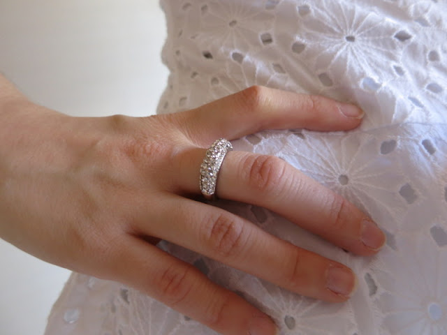 Silver sparkly ring and white shirt