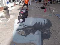 3D Zeichnung auf der Marktstraße in wilhelmshaven, gezeichnet von Alex Maxiov aus der Ukraine.