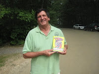 "Father Dom of The Whole in the Wall Gang Camp holding memoir ""Twice"""