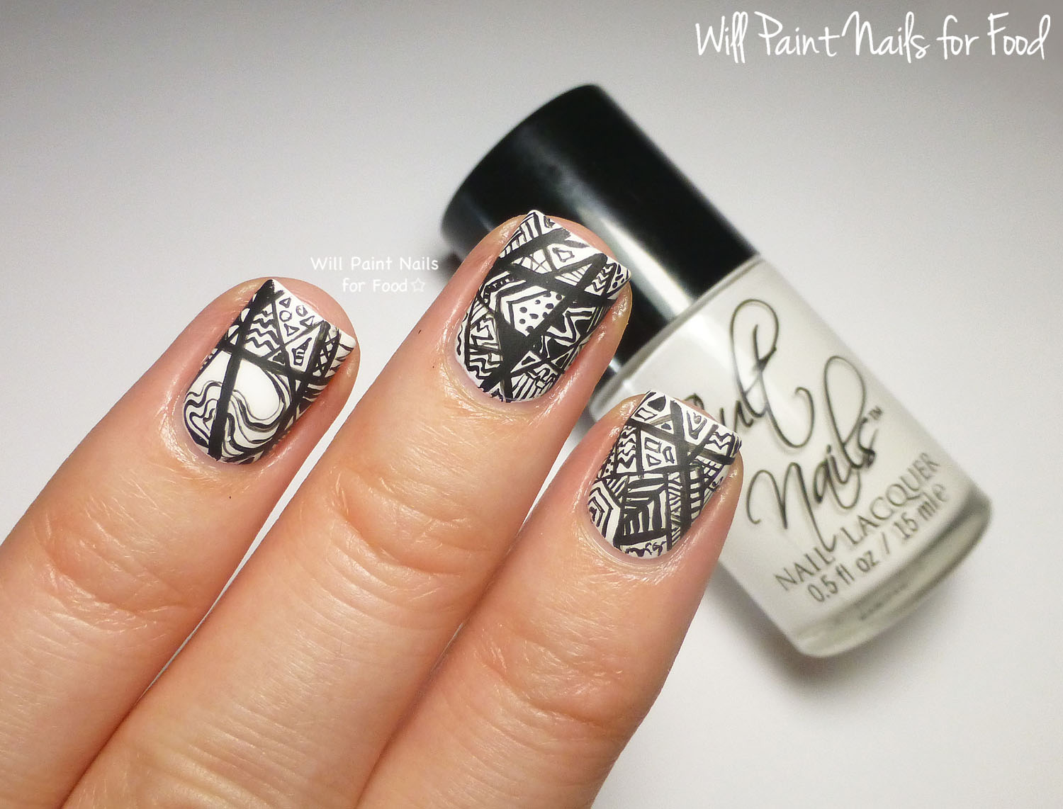 Black and white intricate abstract nail art