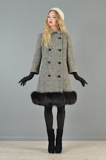 Vintage 1960's black and white tweed Lilli Ann princess coat with black fur trim.