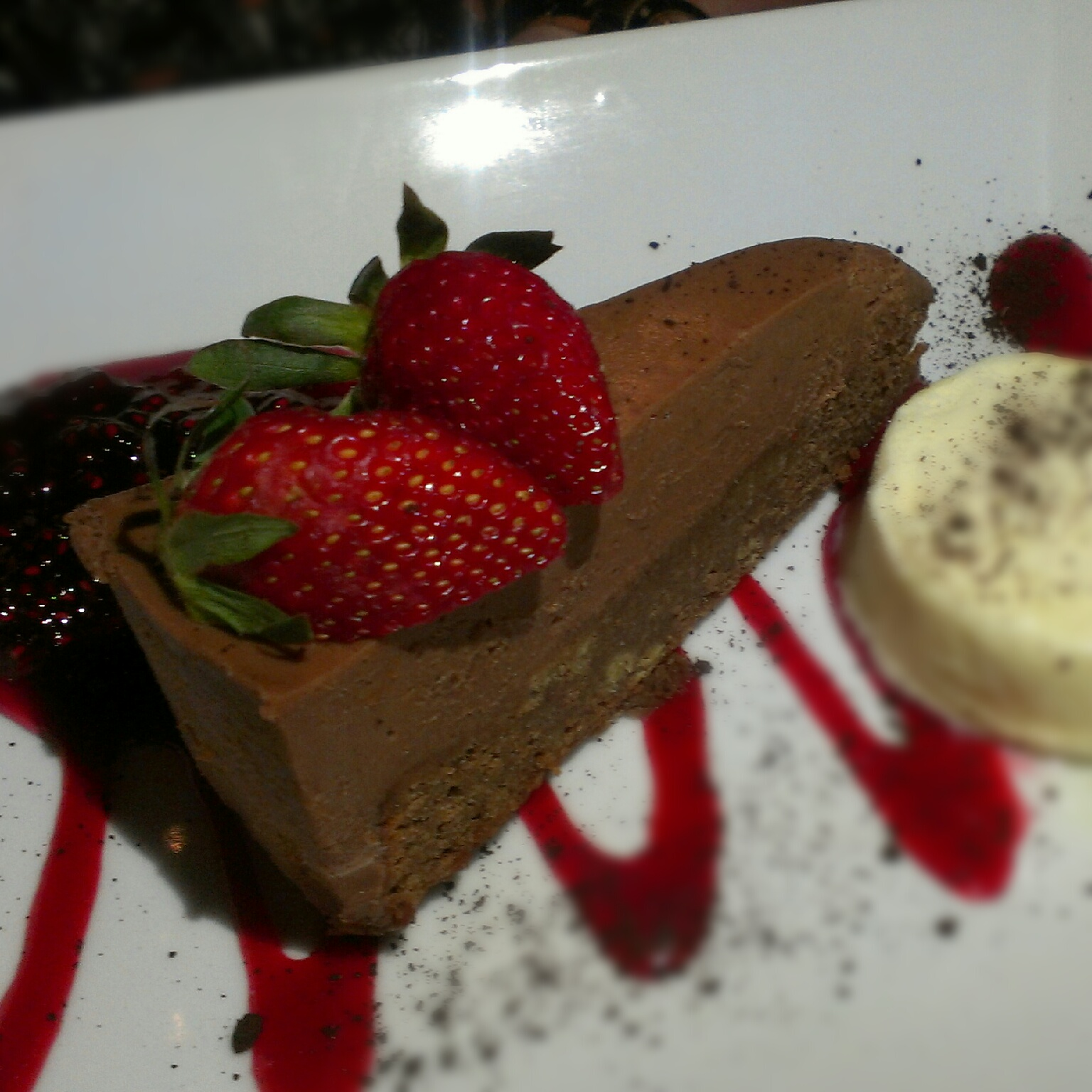 Chocolate chilli tart served with white chocolate semifreddo; finished ...