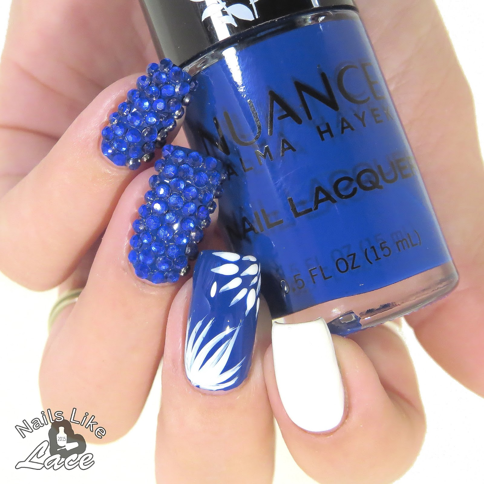 Nailslikelace 40 great nail art ideas new year i used salma hayek nuance blue agave and pro nail lacquer lady in white for some simple firework like bursts and covered two nails with prinsesfo Images