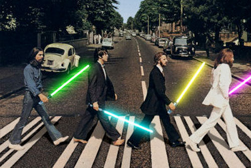 The Beatles Holding Ligh Sabers And Crossing The Abbey Road