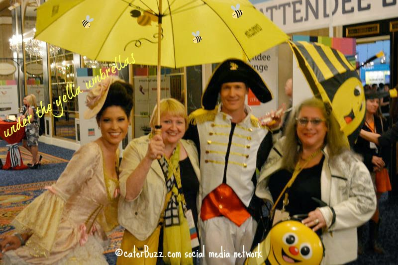 © caterBuzz.com social media network - Napoleon and Marie Antoinette with buzzie social media team members in the hallways at #CSES2014