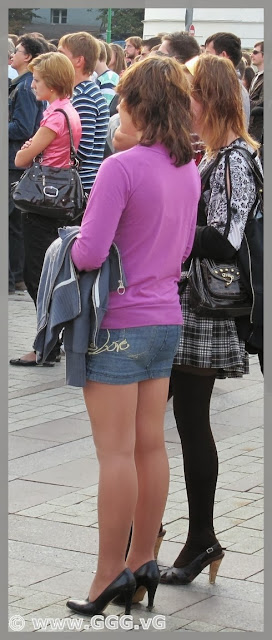 Girl in denim mini skirt on the street