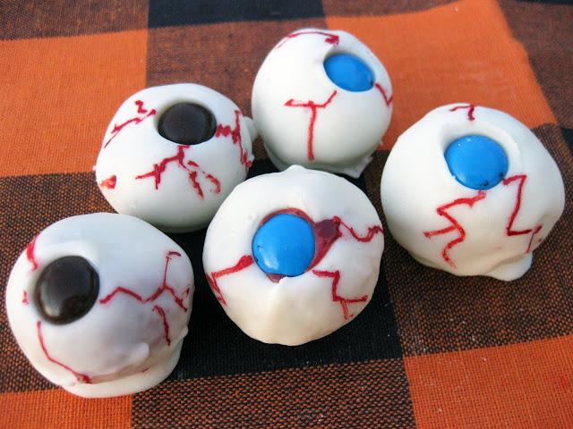 This gross halloween cake ball recipe yields a bunch of edible eyeballs.