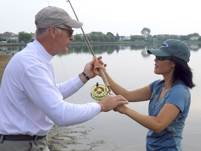 Al Buhr teaching me (Hyun) the circular movements of spey casting