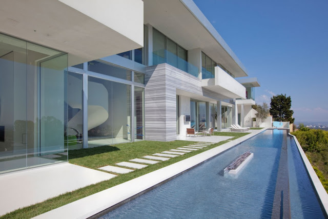 Swimming pool and open facade of modern home in Los Angeles