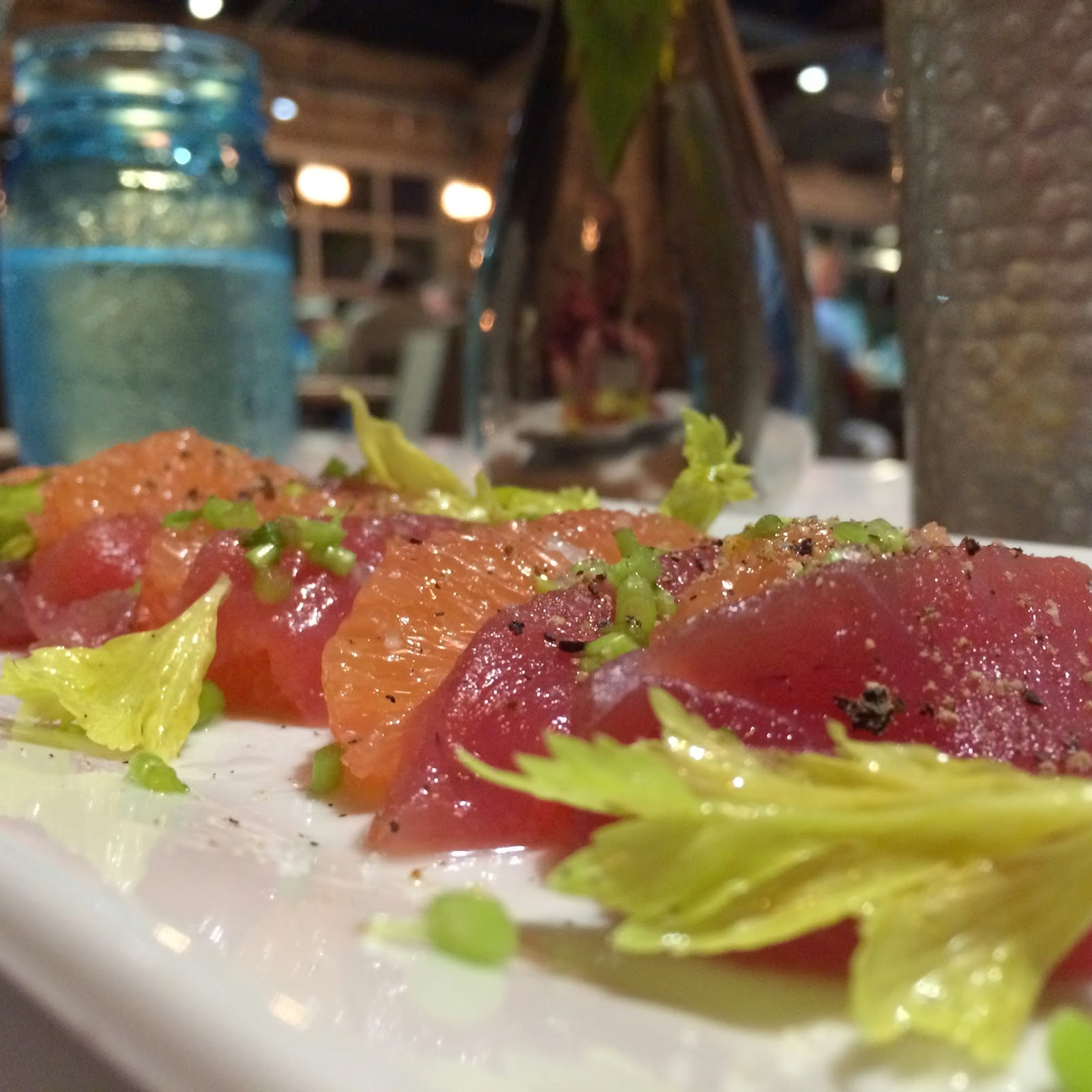 Tiled Fresh Tuna and Grapefruit Slices with Celery Stems at Lucy B. Goode in Gulf Shores