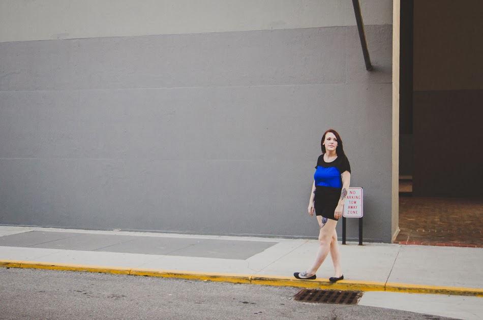 urban girl on a yellow curb is starry-eyed over life, by carmel photographer
