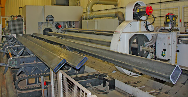 Ducting from Fast Manufacturing's Mazak laser tube-cutting machine leads to a Farr Gold Series GS8 dust collector, located outdoors.