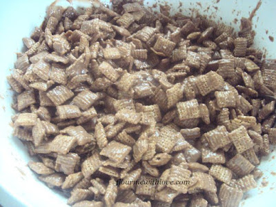 Crispy cereal covered in chocolate, peanut butter and powdered sugar; Puppy Chow
