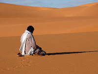 Man praying in Desert