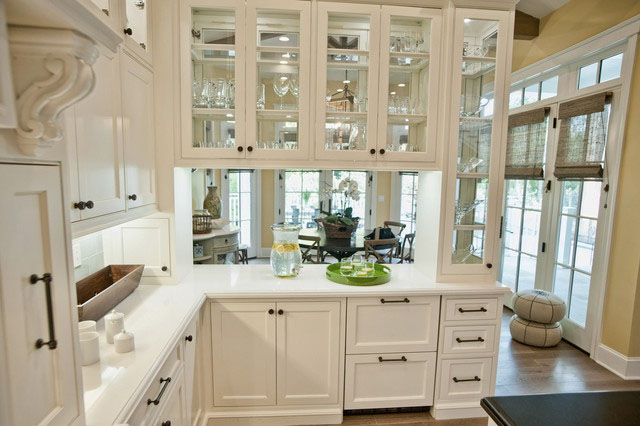 Simplifying remodeling 8 beautiful ways to work glass for Glass upper kitchen cabinets