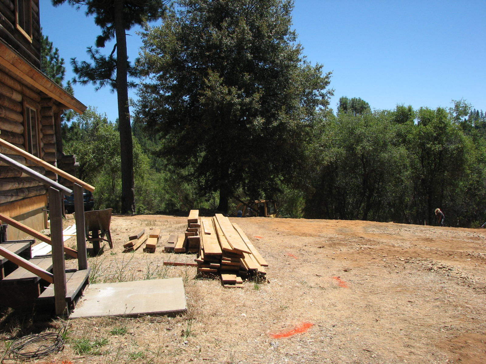 Log cabin septic water tanks excavation road grading for Cabin septic systems