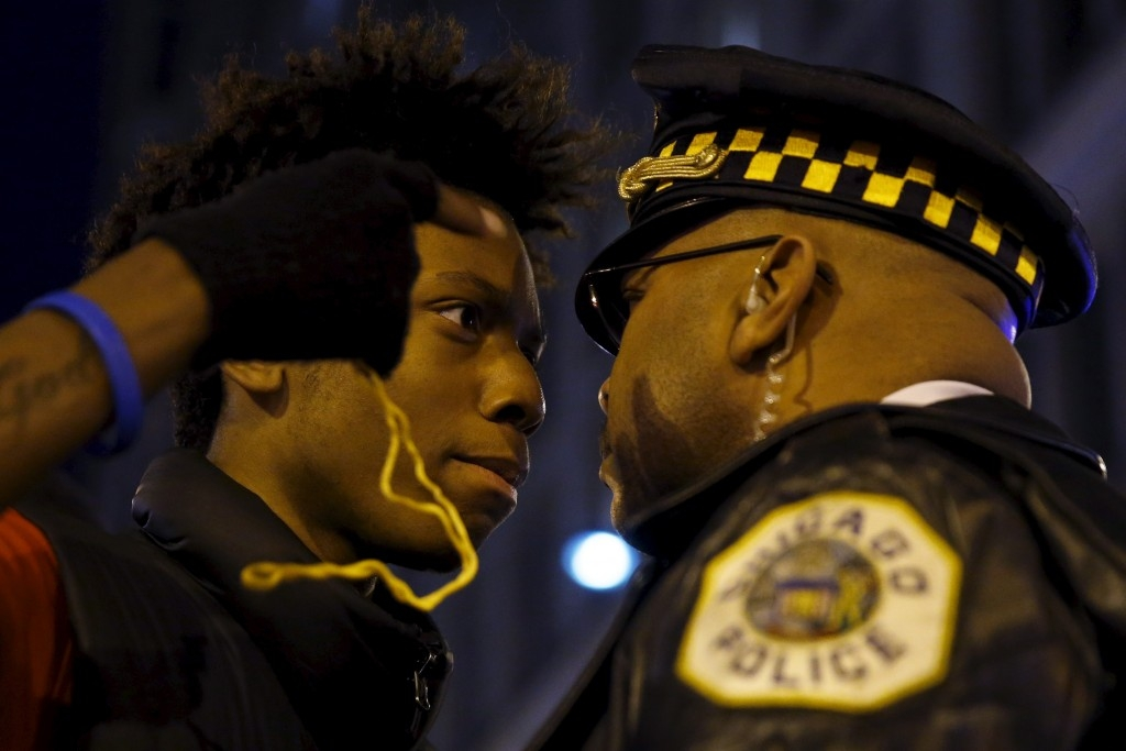 70 Of The Most Touching Photos Taken In 2015 - Protestors confront police during a demonstration in response to the fatal shooting of Laquan McDonald in Chicago, Illinois.