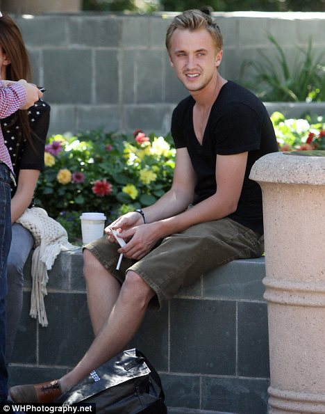 Tom Felton smoking a cigarette (or weed)