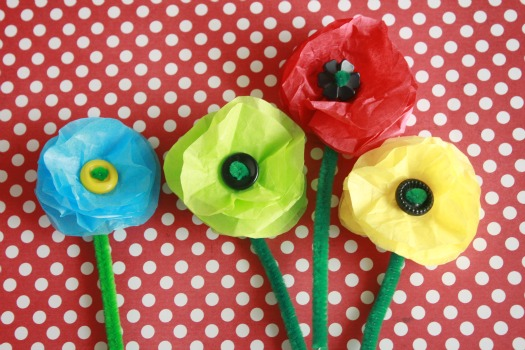 Tissue paper flowers munchkins and mayhem tissue paper is cut into circles and stacked to make the flower next make and takes pokes a green pipe cleaner through the circles and seals them with a mightylinksfo