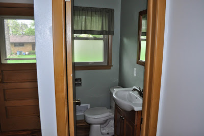 bathroom, vaniety, minwax, stain, elbow grease, polyshades, polyurethane, budget, project, before and after, world market, mirror, lighting