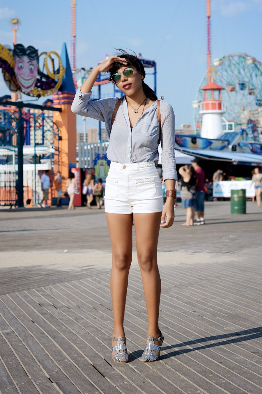 Indie Fashion Blogger Anais Alexandre of Down to Stars in a preppy outfit made punk by dark lipstick and leather cuffs on a day trip to Coney Island