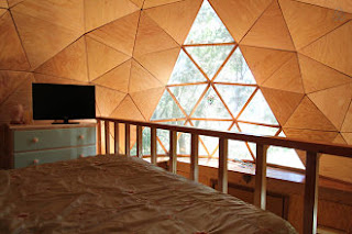 Upstairs loft at Mushroom Dome Cabin has a double bed
