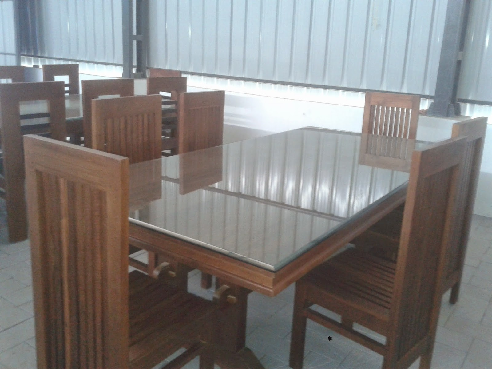 Kerala style carpenter works and designs december 2014 for Latest wooden dining table designs