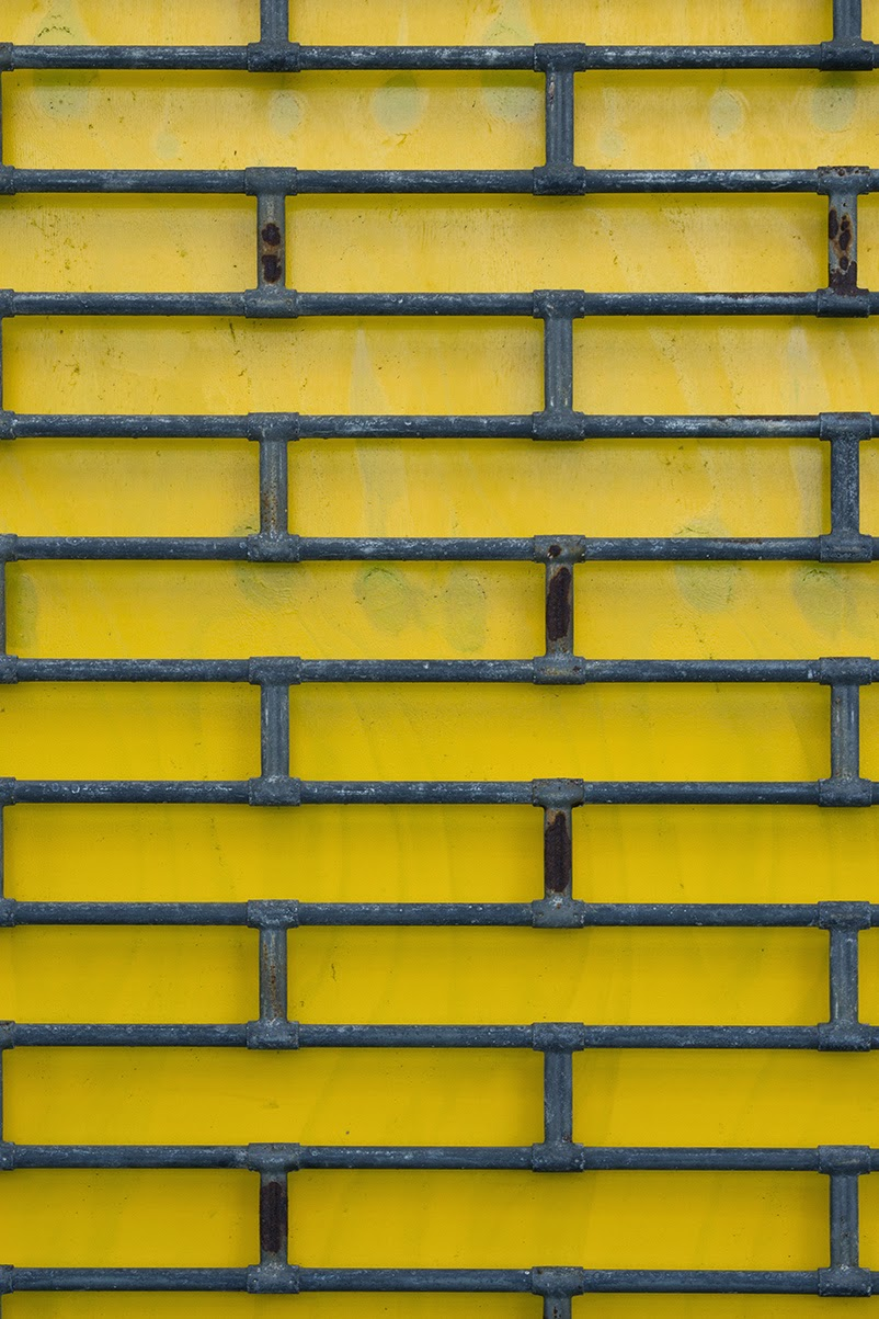 yellow wall with grid